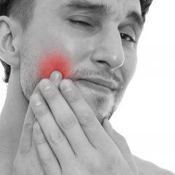 Você tem dor na face, cabeça ou dentro da boca?